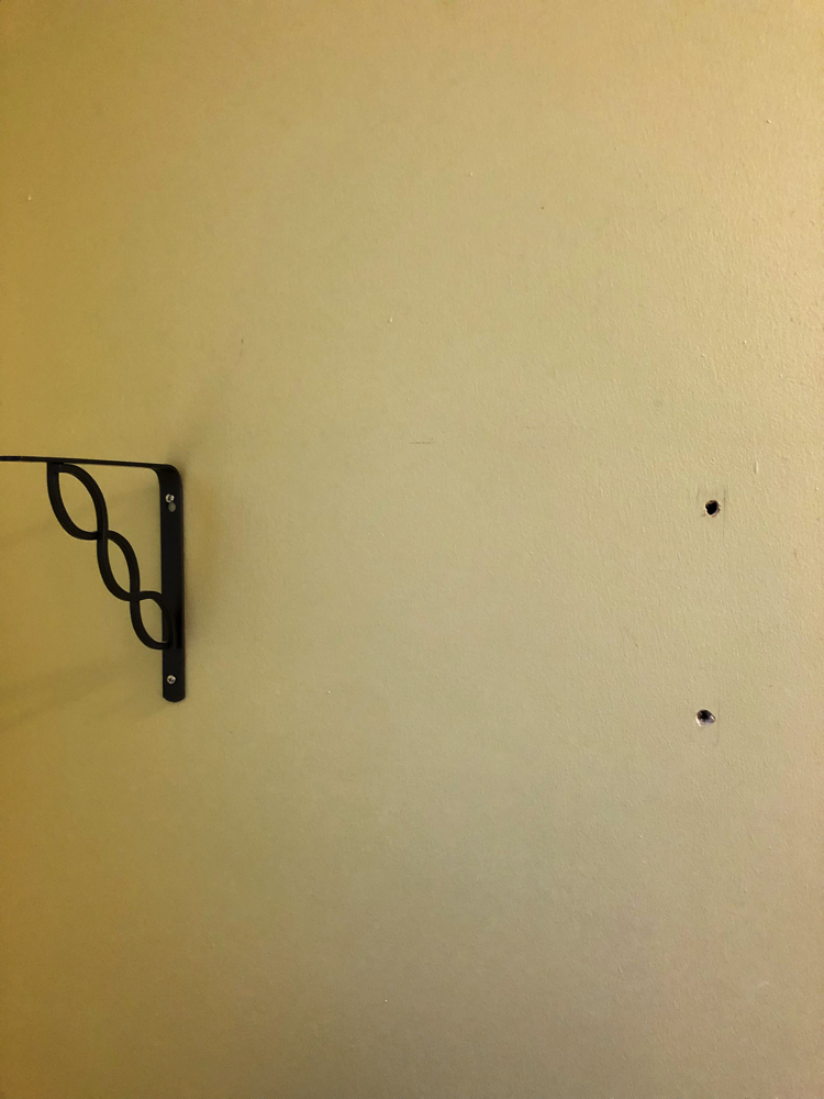 When I removed a shelf from our bathroom wall, the toggle bolts left huge holes in the wall.