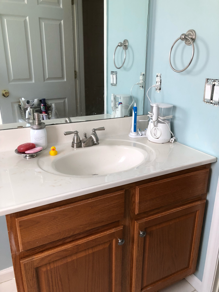 A bathroom painted in Yarmouth Blue by Benjamin Moore