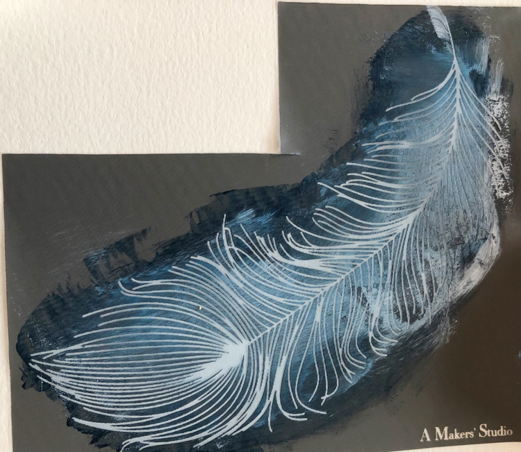 blue and white paint on a feather stencil