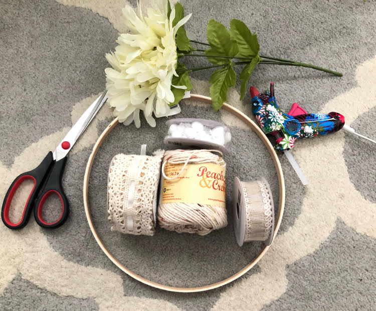 supplies for making a simple dream catcher from an embroidery hoop