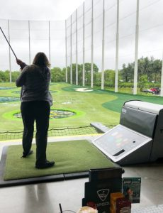 Lauren of Mom Home Guide golfing at Topgolf in Mount Laurel, NJ