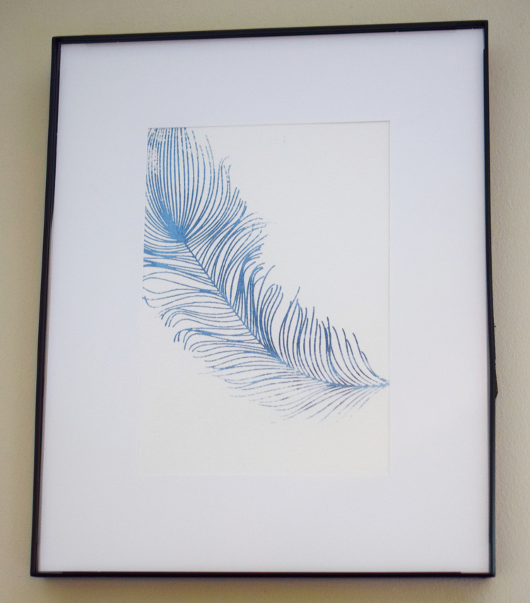 A beautiful stenciled feather from A Maker's Studio stencil