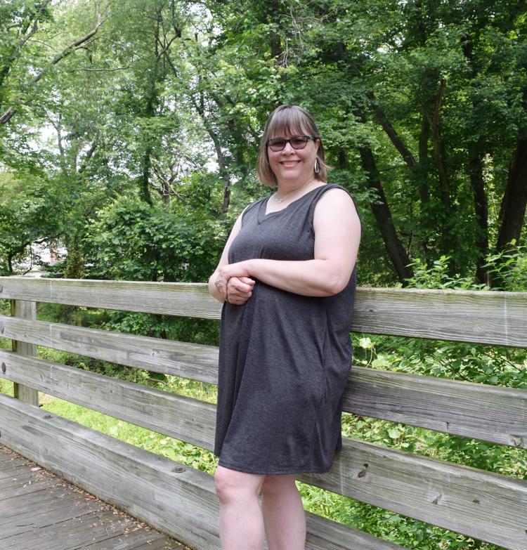 gray sleeveless pocketed dress