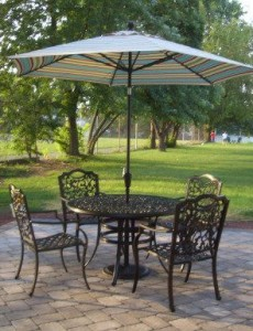 paver patio with wrought iron patio table and chairs
