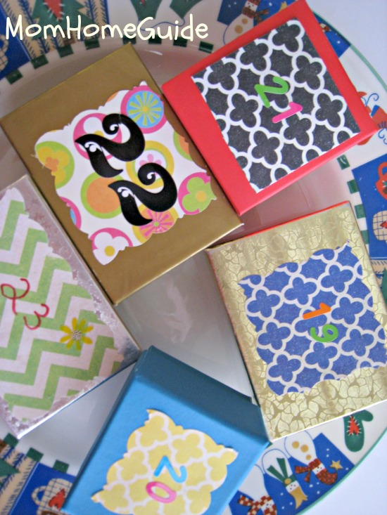 advent calendar boxes decorated with scrapbook paper for Christmas