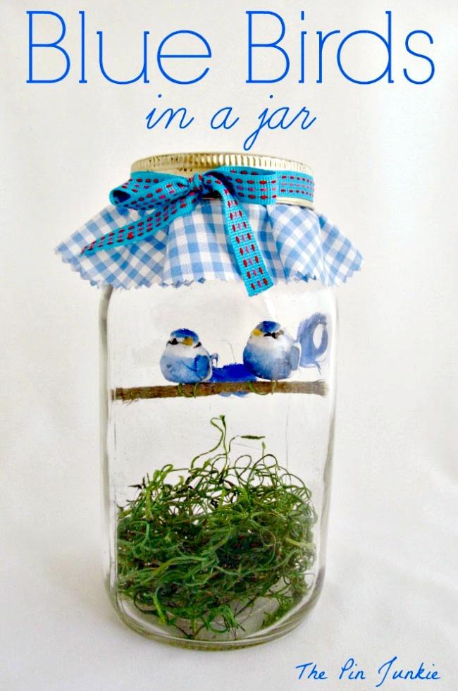blue birds in a jar
