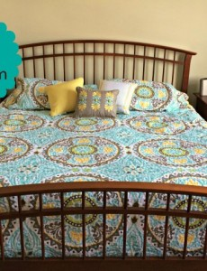 master bedroom with a king-sized bed, spindle bed and colorful quilt