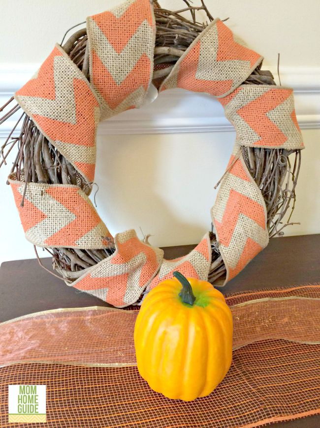 I love how this pumpkin and autumn chevron grapevine wreath looks on this walnut console table!