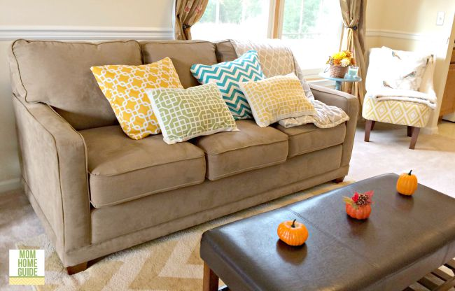 I like to keep my home's living room light, bright and colorful for the fall to combat the shorter days!