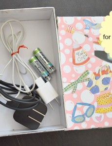 A decorated gift box makes great storage for storage of gear for cell phones and electronics