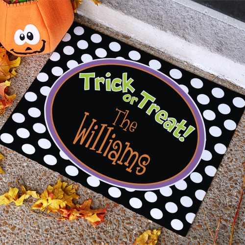 I love this super cute personalized Halloween door mat!