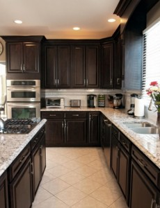 Remodeled kitchen with refaced dark cabinets and Cambria Quartz countertops