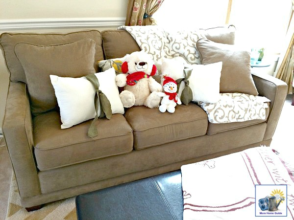 A living room sofa decorated for winter