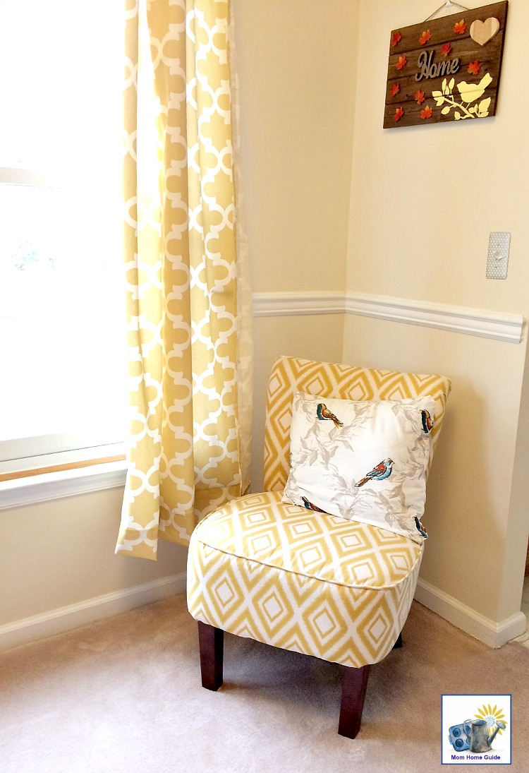 Living room with yellow and white accent chair and curtains