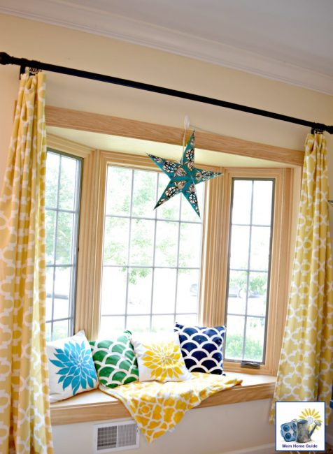 bright and sunny window seat with colorful throw pillows