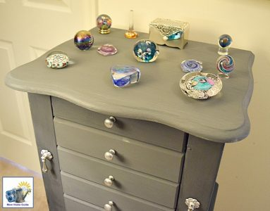 Jewelry Armoire Decorated With Beautiful Gl Paperweights