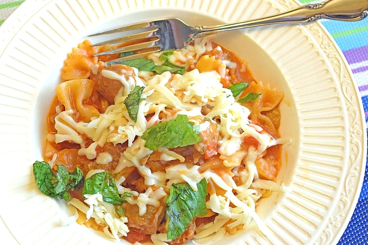 easy and delicious one-pot pasta recipe with farfalle pasta, sausage, mushrooms, red peppers and shredded mozzarella cheese