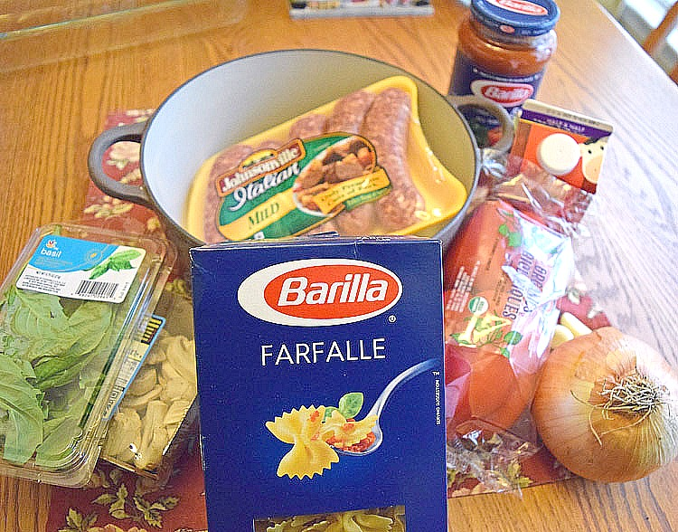 ingredients for a cheesy sausage pasta dish