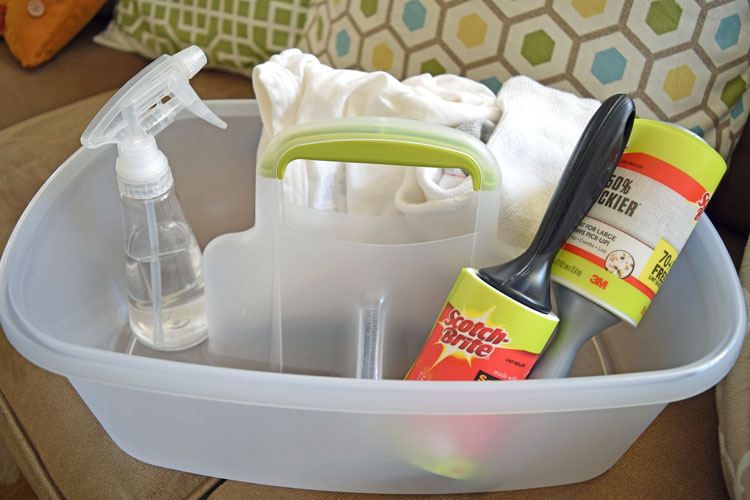 A dusting cleaning caddy water spray bottle, an old tea shirt and sock, and a lint roller. All these items are great at trapping dust!