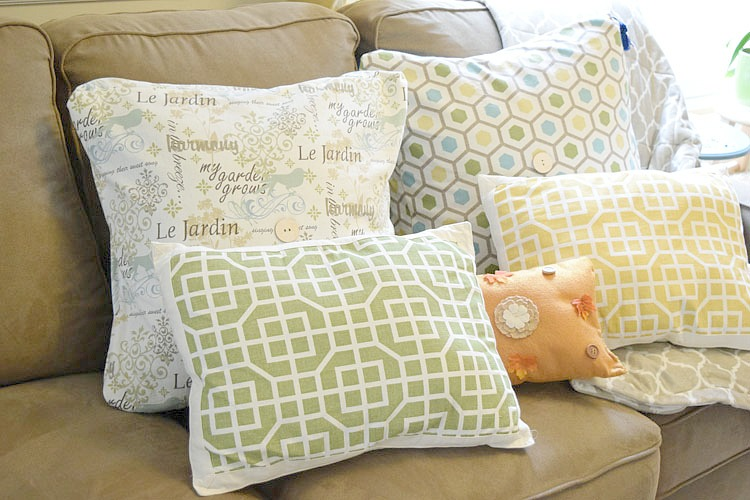 Pretty pillows on a sofa decorated for fall