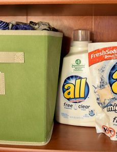 "Using, pretty cloth bins, you can create ""closet"" space in a simple bookcase."