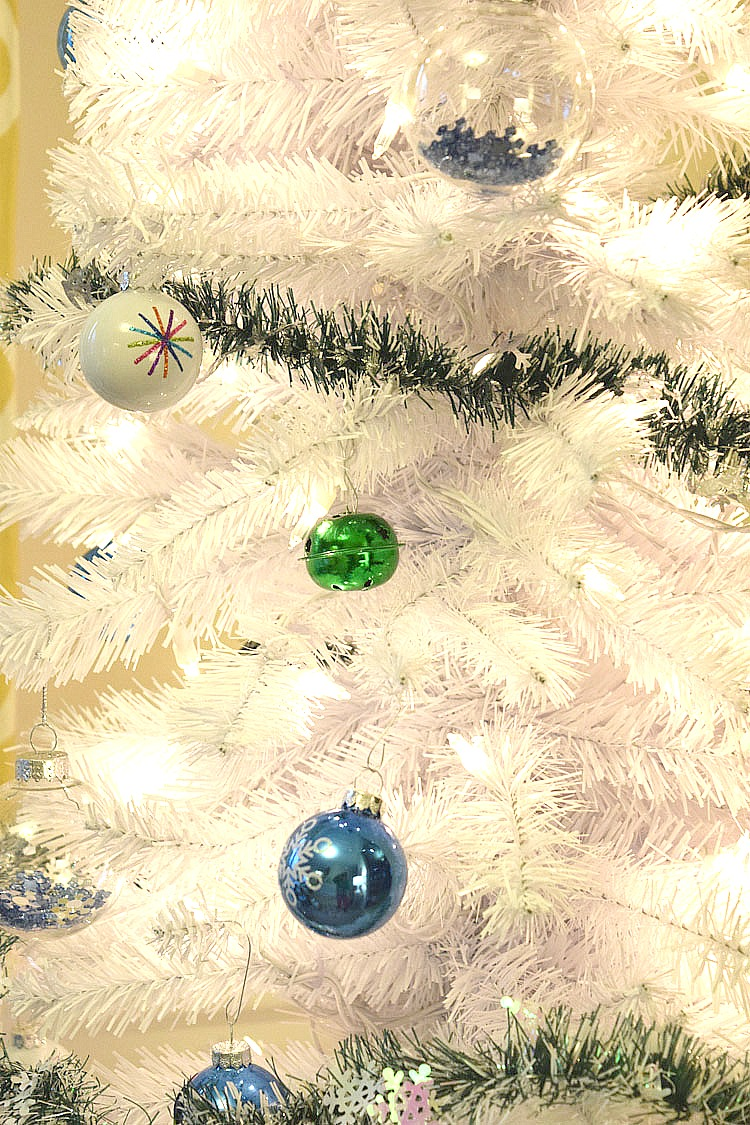 white Christmas tree with blue and green ornaments