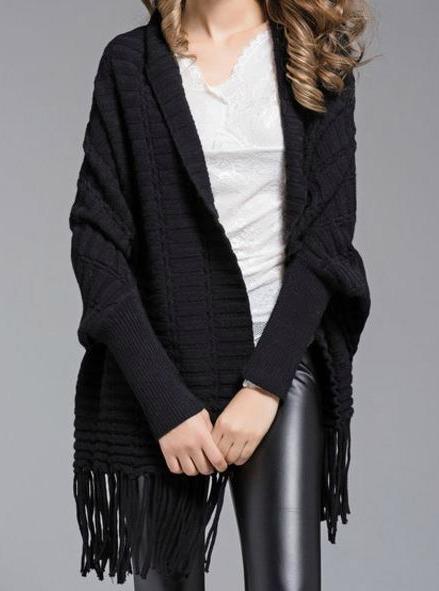 fringed black sweater