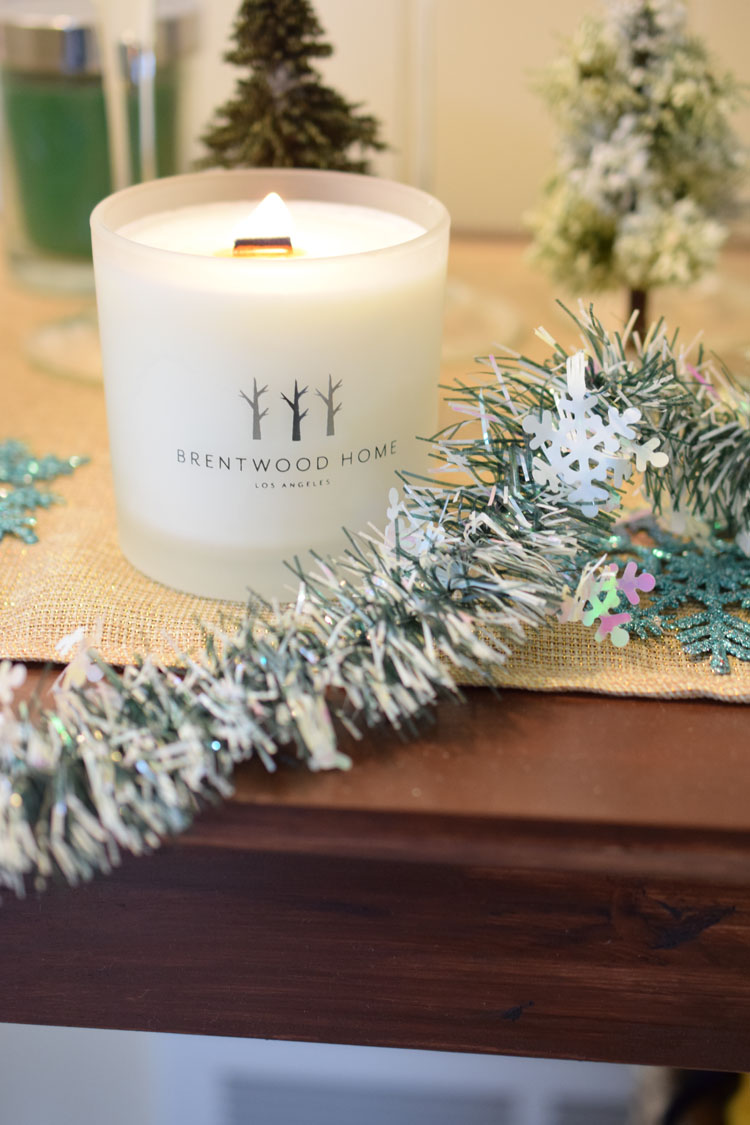 White soy candle on Christmas console table