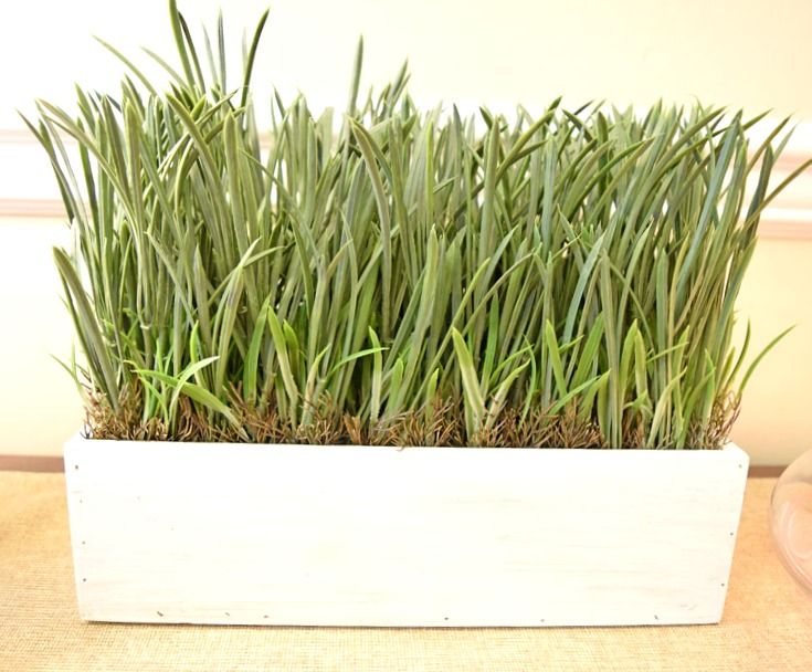 faux greenery in a white rectangular wood planter