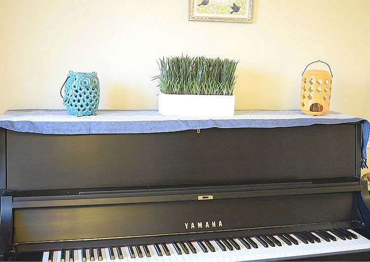 decorated black upright Yamaha piano