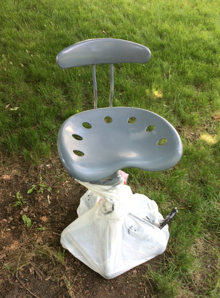 gray spray painted chair