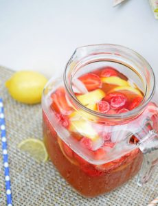 Fresh strawberries and lemons in a strawberry lemonade iced tea recipe