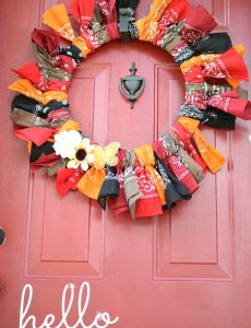 Colorful fall bandana wreath on a red front door