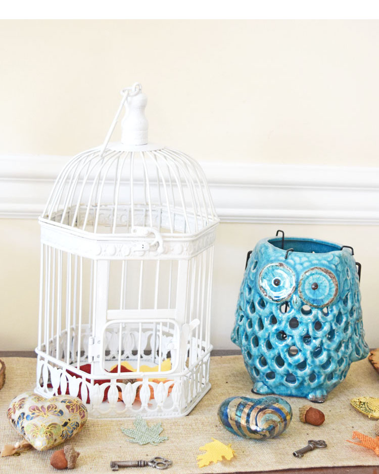 fall console table with white birdcage and blue lantern
