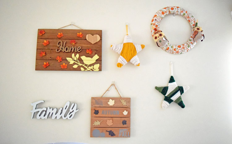 DIY fall gallery wreath with homemade signs, yarn wrapped stars and wreath