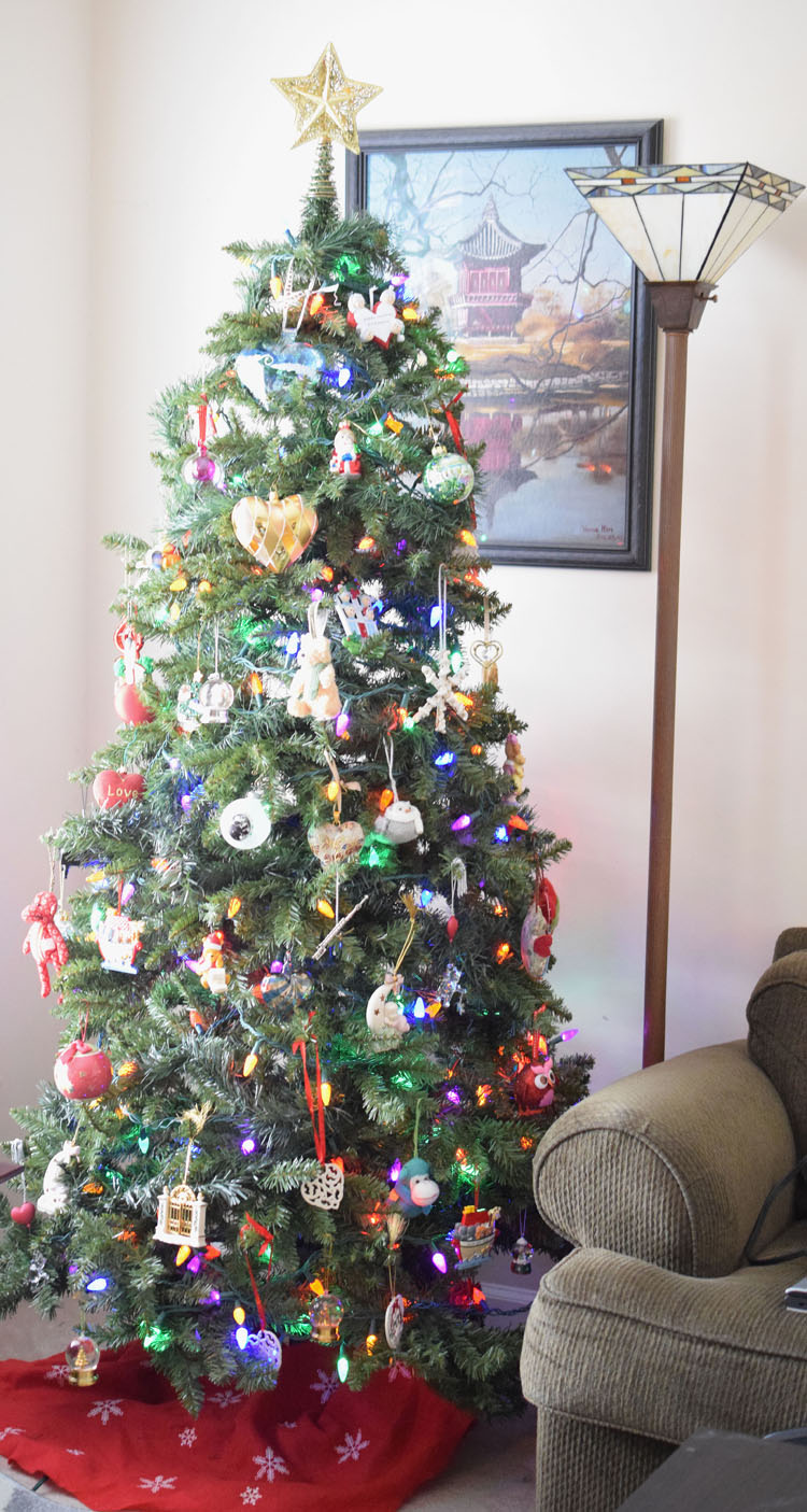 a family Christmas tree decorated with sentimental ornaments collected over the years