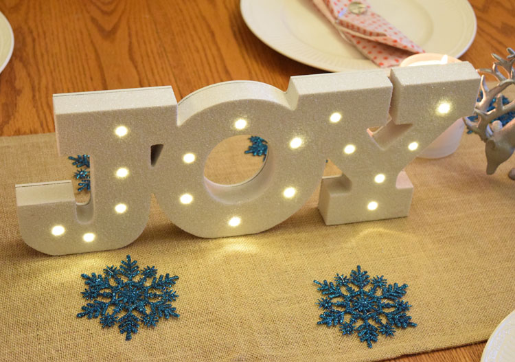 lighted Joy marquee sign for Christmas and the holiday season