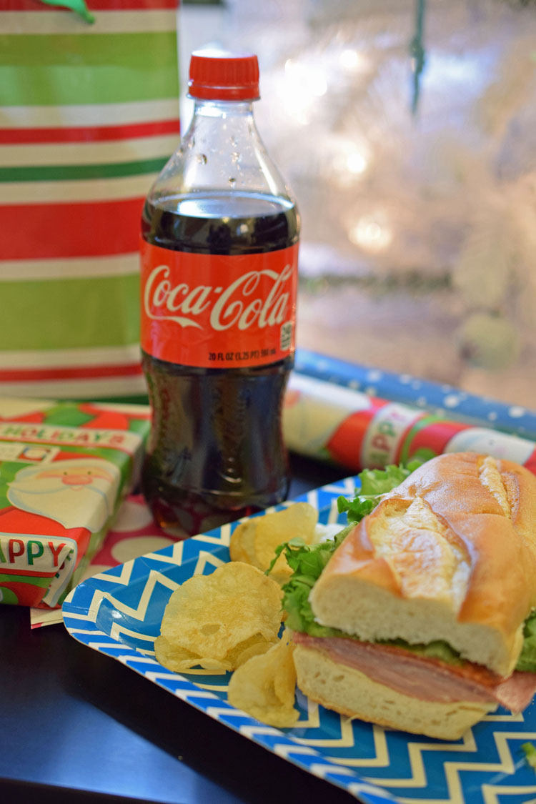 Enjoying an afternoon of gift wrapping with a Coca-Cola deli meal combo from Stop & Shop