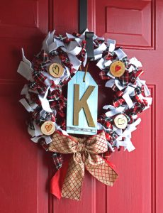 This wreath is easy to make with ribbon, strips of felt and wood slices.