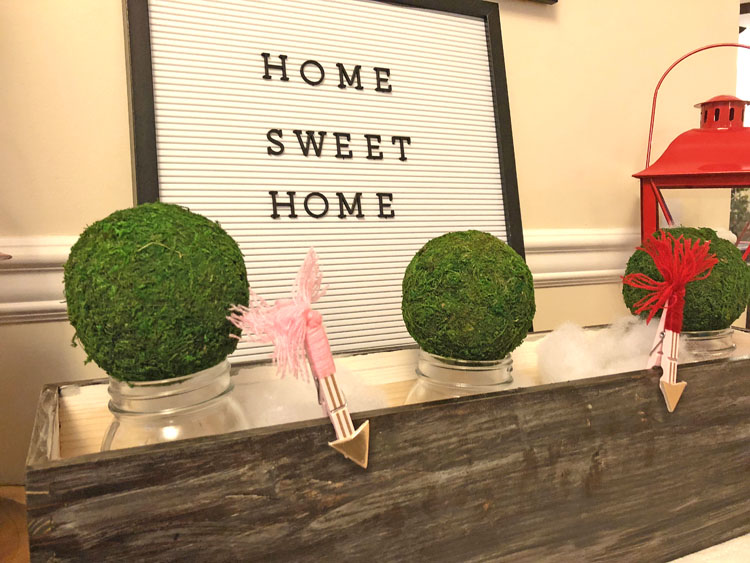 cute letter board on a Valentine's Day console table