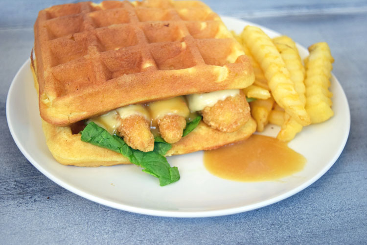 An easy and fun dinner recipe for a chicken and waffles sandwich with pepper jack cheese and a maple honey mustard sauce
