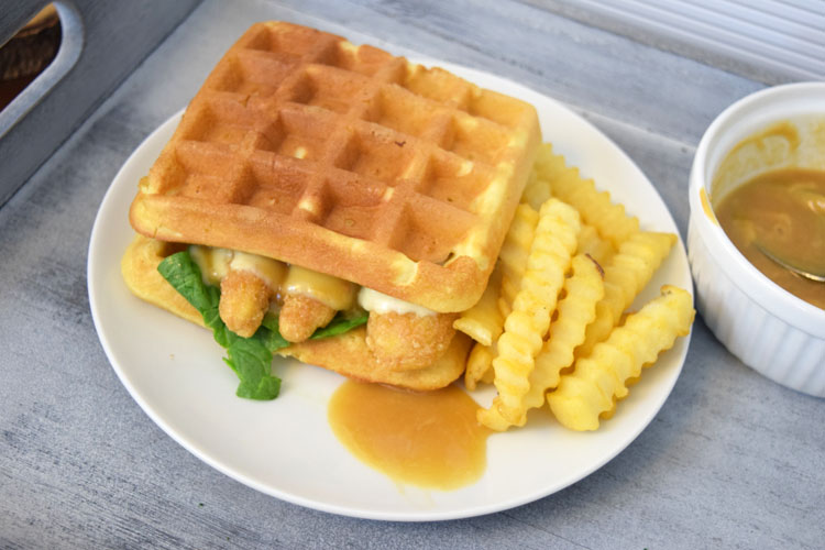 chicken and waffles sandwich with pepper jack cheese and a maple honey mustard sauce