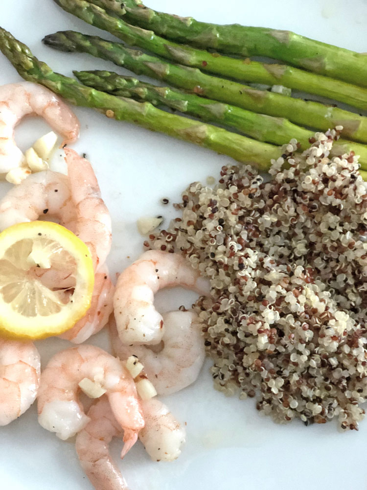One sheet pan dinner of shrimp and asparagus with garlic and lemon juice