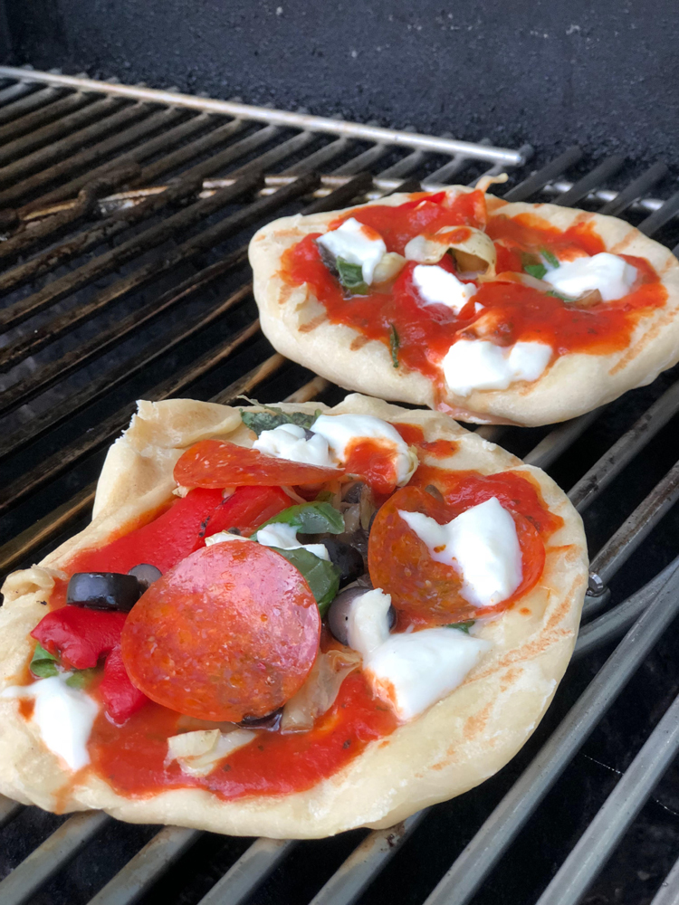 Easy and delicious recipe for grilled personal pizzas on the grill