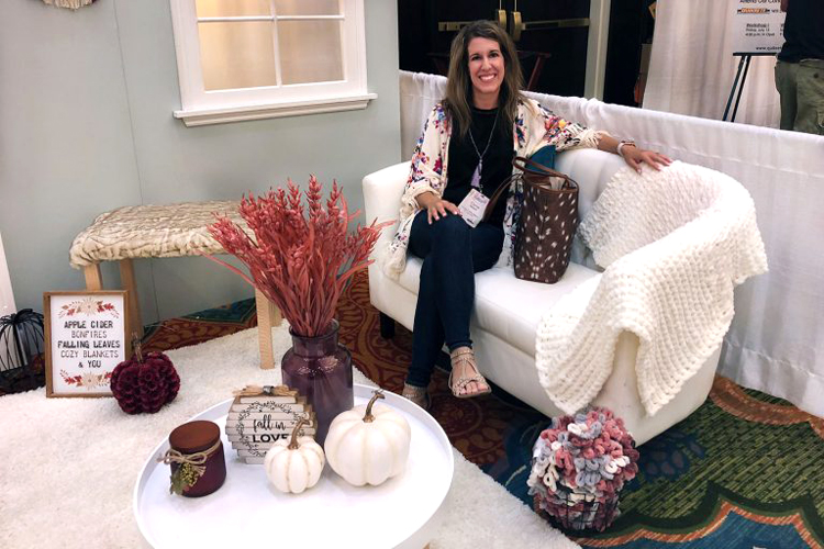 blogger Carrie of Curly Crafty Mom at Joann's booth at the Haven blogging conference in Charleston, S.C. in July 2018