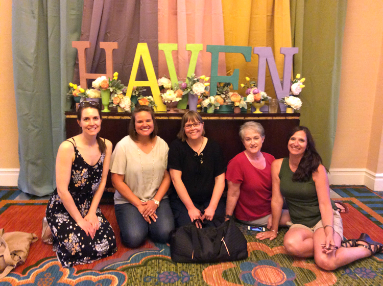 Bloggers seated in front of colorful Haven letters at the 2018 blog conference in Charleston, S.C.