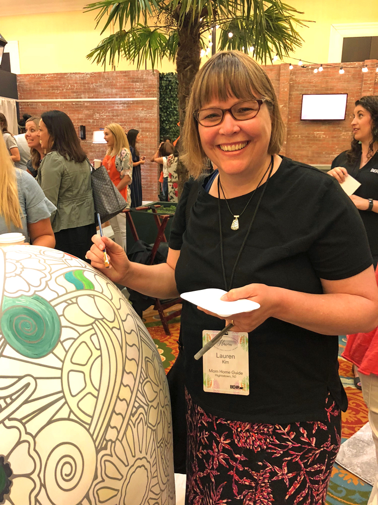 lauren kim of mom home guide painting the behr bear at the 2018 Haven blog conference in Charleston, S.C.