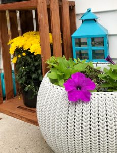 tuquoise lantern, walnut stained crate and mums on a fall front porch