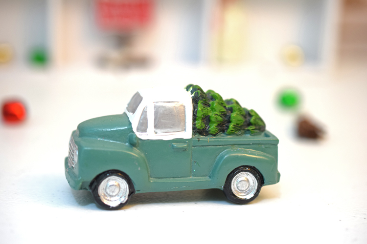 Miniature green pickup truck with Christmas tree from Target. #christmasdecor #target #christmas