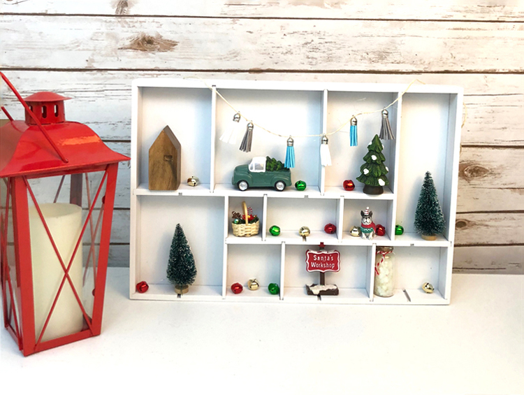 I love this easy DIY white shadowbox display case for sweet Christmas village miniatures.